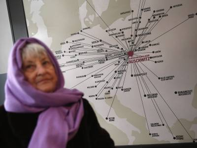 Rose Schindler, 85, who is a survivor of the Auschwitz-Birkenau concentration camp, turns from a map showing all the cities from which arriving Jews at Auschwitz.