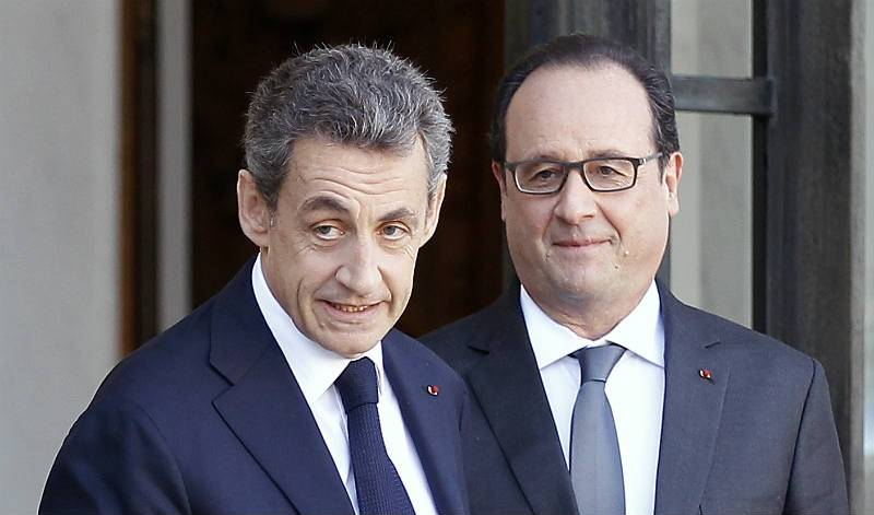 Hollande and Sarkozy argue over Poland
